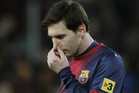 Benched: The weight of a nation and Barcelona's football fans throughout the world rest on Lionel Messi's shoulders... will he sparkle as a substitute? (Reuters file)